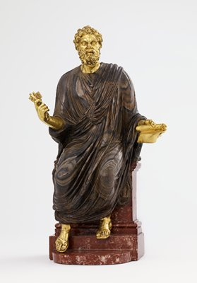 male figure wearing a robe carved from brown-veined rock, seated on a red and cream stone plinth; head, hands and feet of gilt bronze; curly hair and beard; wearing cap; man holds scroll in PL hand and two keys in PR hand
