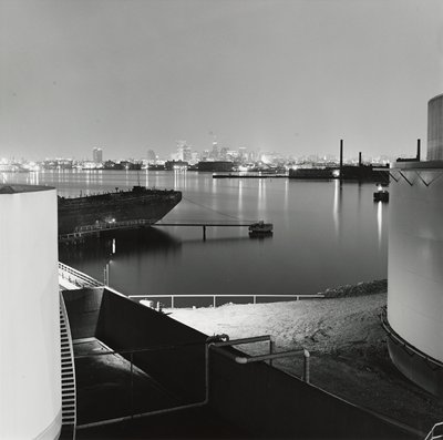 boats, docks and nighttime skyline at horizon line