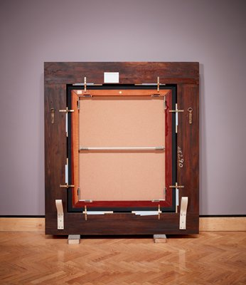 "carved frame around blank canvas, displayed with back of frame facing out, resting on two blocks covered with blue carpet; back of canvas is covered with cork; two large twill straps screwed into frame at bottom; tension springs and rods at corners and center of stretcher; handing loops at left and right sides; ""E8290"" in white on right side of frame; MIA's permanent collection label for Rembrandt's ""Lucretia"" at top; small MIA loan tag in ULC Scotch taped to stretcher; scallop-edged sticker at top center on stretcher; white tape on shims between stretcher and frame edges"