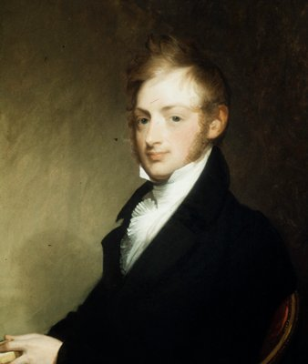 portrait; seated three-quarters to the left. eyes dark blue, hair and side-whiskers light sandy color; left hand resting on table holds a book into which his index finger is thrust; black coat, buttoned, white collar, neckcloth and a starched ruffed shirt.