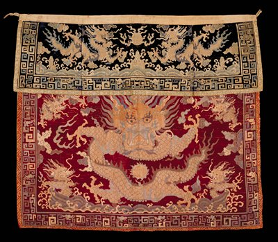 Altar apron; made of two pieces, bottom piece cut dark red velvet with large dragon in center; top, cut dark blue velvet background with dragon and geometric border.