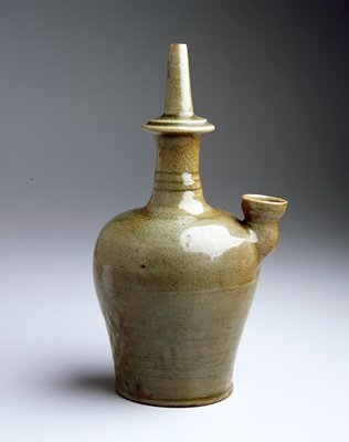 Kundika (holy water bottle) high shouldered, ovoid body with tall neck and small spout; celadon, olive green glaze