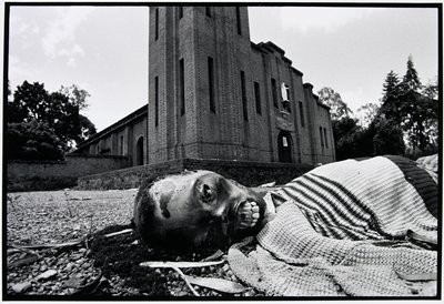 decomposing body on street in front of a church
