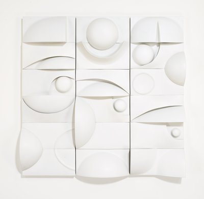 three vertical white panels, each broken up into six horizontal sections; panels have protruding arcs, circles and half-circles; left panel has wedge at top; center panel has protruding globe at top; right panel has globe with slit at top