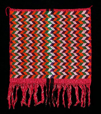 Red ground with fine black and white warp ikat stripes, intercepted by two fine white stripes; supplementary weft patterning in green, orange and white rayon arrows; macramé at fringe.