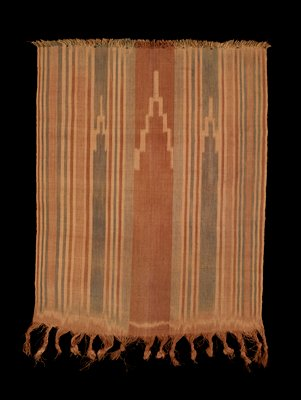 tan, brown and grey pattern of stripes and 3 stepped arrowheads; short fringe on one side, long twisted and tied fringe on opposite side