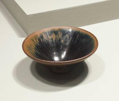 Tea Bowl, brown pottery covered with black glaze. Rust color at rim. Chien ware, Fukien Province.