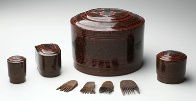 cylindrical box with stepped cover; inlaid flower on cover; organic and geometric patterns overall in red and brown