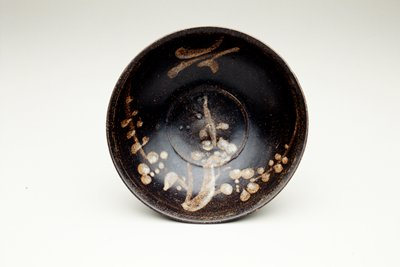 bowl, flared sides with finger groove below rim; interior design, prunus branch and crescent moon; dark brown glaze; knife cut foot with no glaze