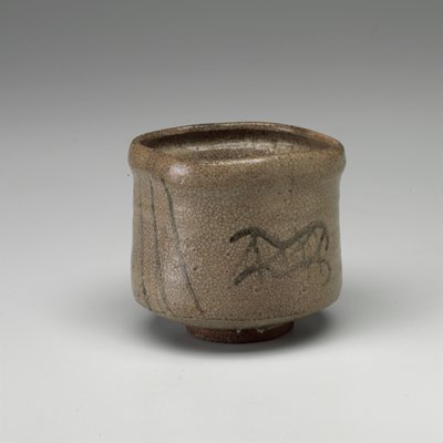 squared form, with high walls; small ring foot; milky translucent glaze; stylized depictions of bridges and water, in brown