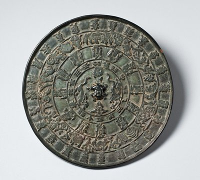 round bronze medallion with raised knob at center; five bands inside encircling center knob; each band with different figures inside including four directional guardian animals and twelve zodiac signs in relief