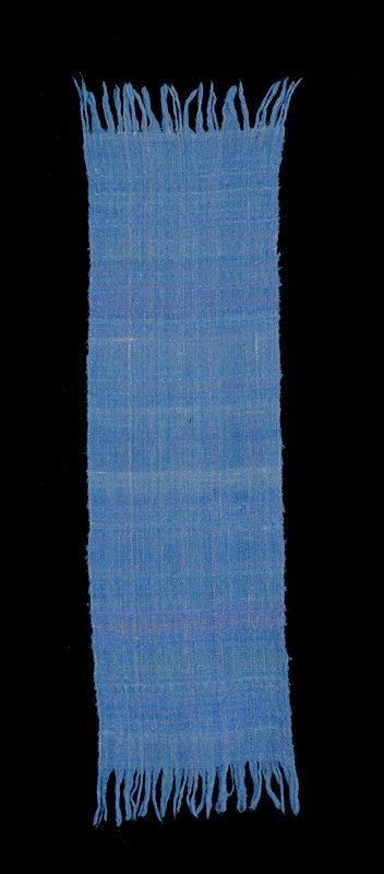 medium blue scarf with purple and light blue mixed in; fringe on each short side; wrap-spun with rayon which was chemically removed. Woven fabric