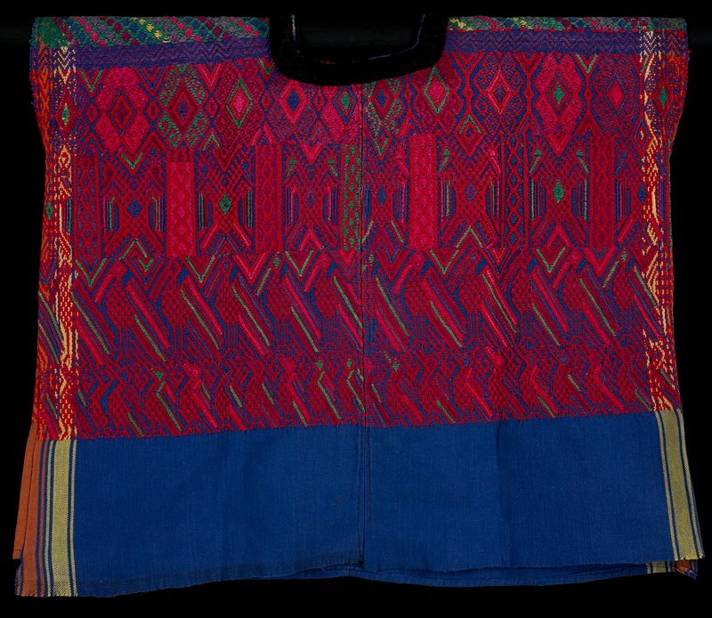 blue body with yellow and orange stripes at sides; top decorated with predominately red design of birds, and diamonds and other geometric motifs; rounded neckline trimmed with black velvet ribbon
