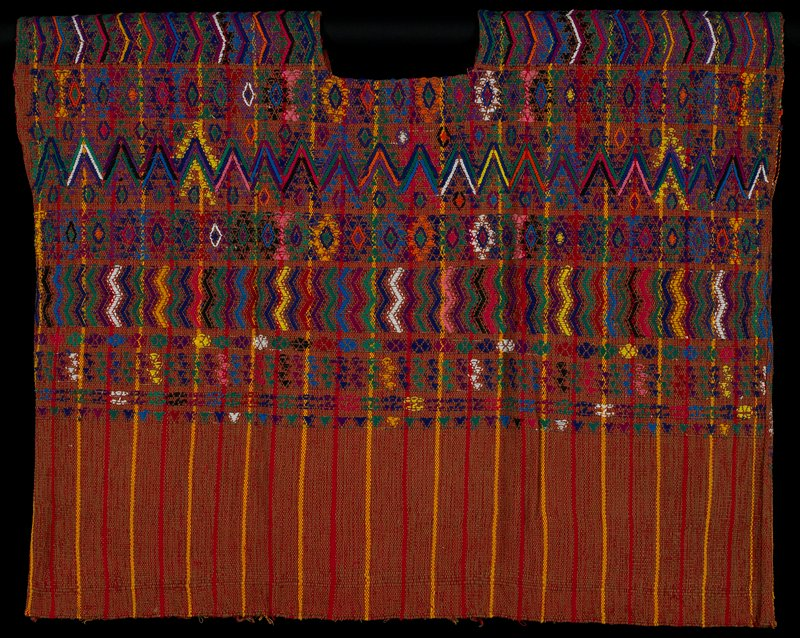 warp woven with brown, and red and yellow stripes; rounded neckline; multicolored brocaded designs of zigzags, flowers, diamonds and geometric designs