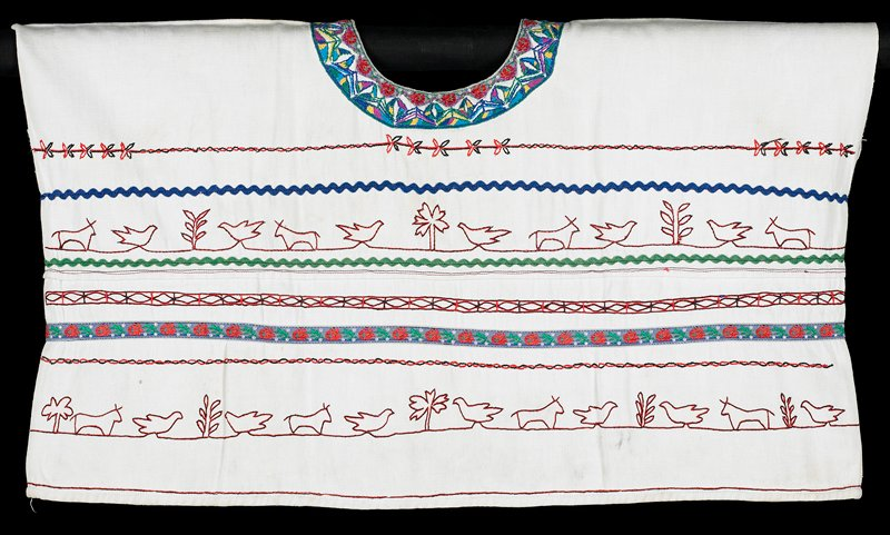 woman's huipil embroidered in red and dark blue or black with animals, birds and plants; rickrack in blue and green; floral ribbons; multicolor neck embroidery