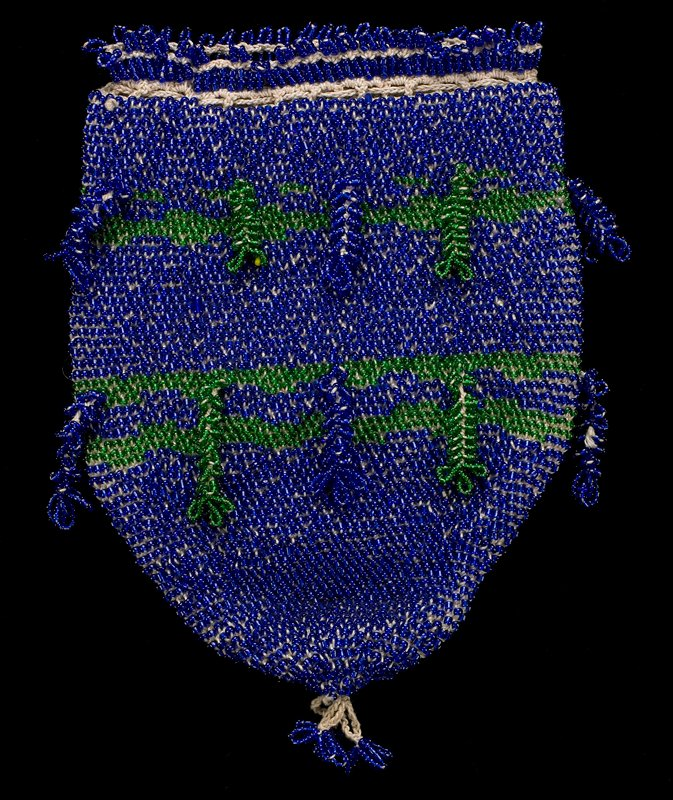 small rounded pouch with draw cord at top with ends trimmed in blue bead tassels; blue beads overall with green stripes; 16 beaded tassels on body; three beaded loops at bottom