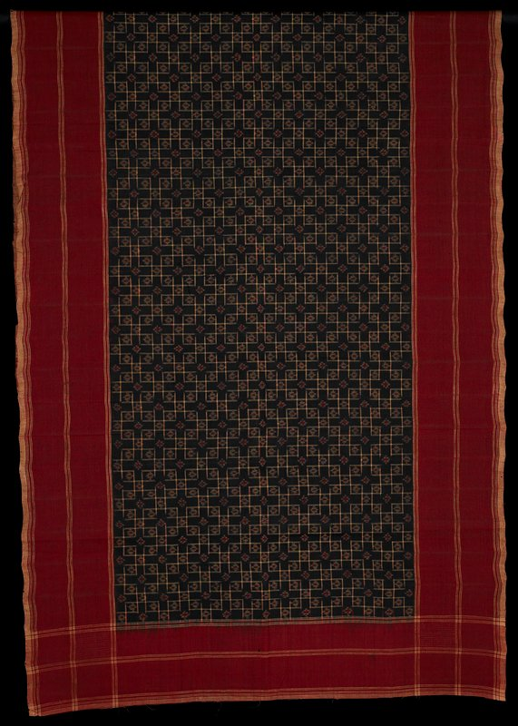 maroon borders with cream-colored stripes and plaids in intersecting striped areas; central black ground section with cream checks, and red and cream ikat-pattern designs; sized/starched