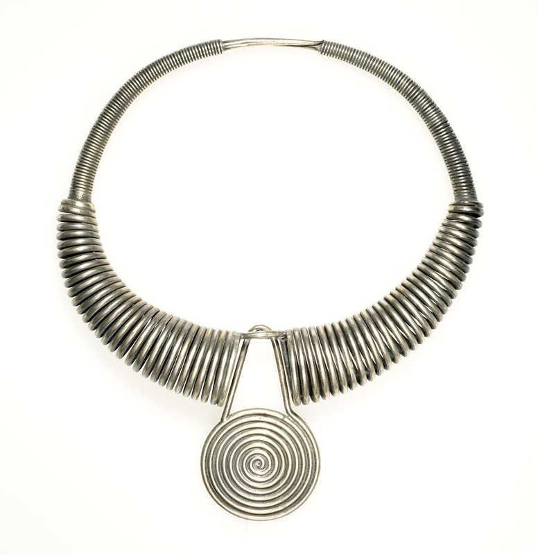 single ring starting as thin coiled wire thickening as it approaches center; at center one dangling curlicue attached to a buckle shaped piece