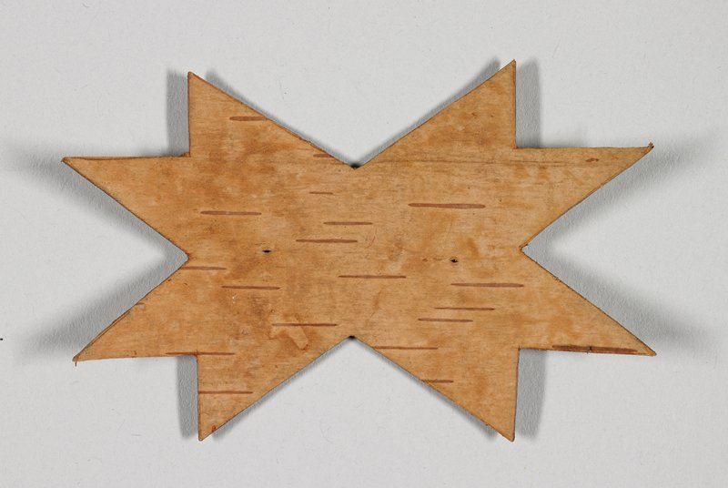 star form with eight points; dark brown on one side, light brown on opposite side