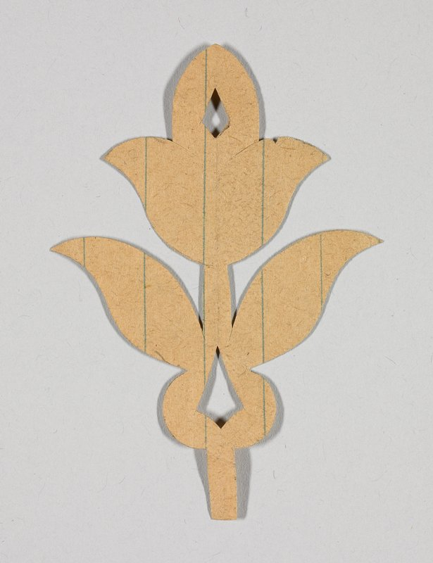 tulip-shaped flower with diamond cutout at top; two leaves on stem with second cutout at bottom; ruled paper