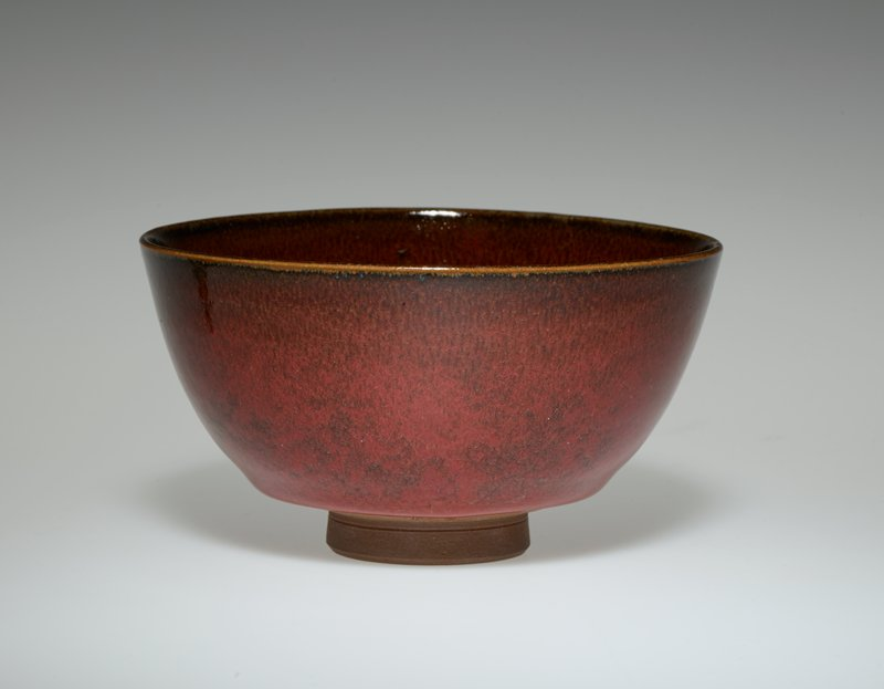 tea bowl; rather tall ring foot; rounded form; brown clay; red and brown mottled glaze