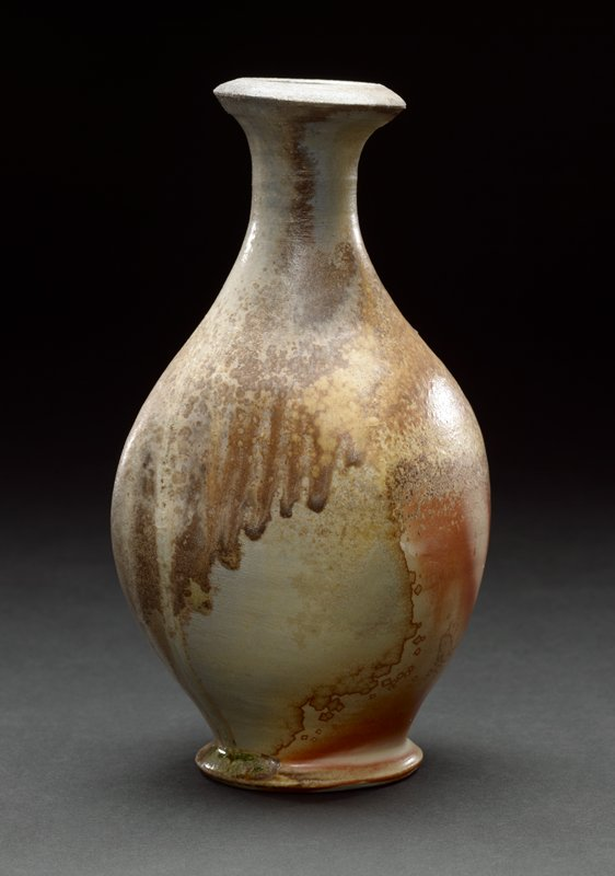 round, flat base; rounded body, slightly squared-off; long tapering neck; thick mouth rim; mottled light red, cream, light grey, green, brown, tan, grey