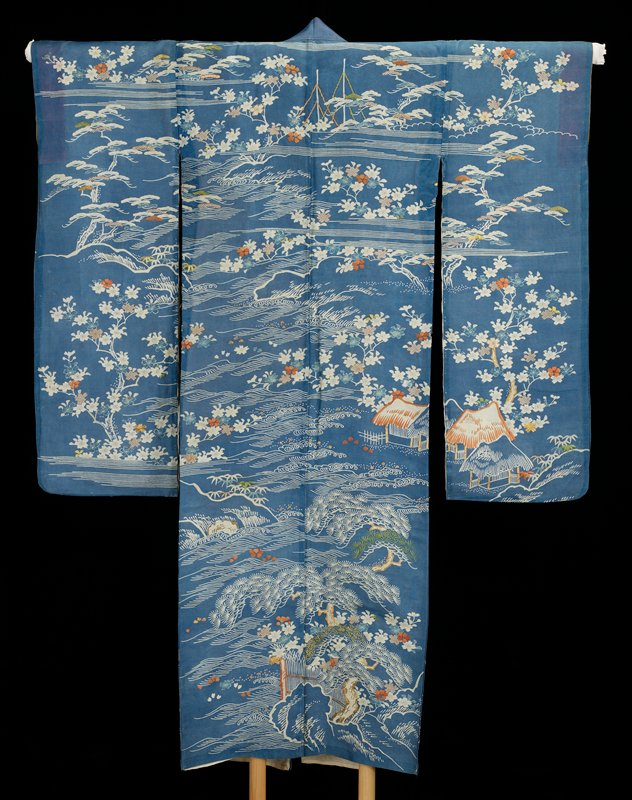 blue ground with design of flowering trees, waves and houses