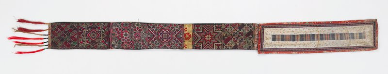 two sections; shorter section backed with blue fabric is pieced with central pastel striped fabric bordered by white fabric printed with tiny pink and yellow flowers and embroidered bands and red floral printed fabric; longer section backed with grey and pastel woven fabrics has three brocade bands (one with metallic silver threads) and six embroidered cross stitched rectangles in predominately pinks and purples; red and white tassels with beads at one short end