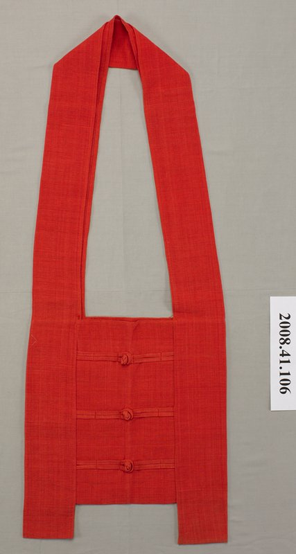 pale red--salmon-colored loosely-woven fabric; wide strap; front of pouch has three decorative knot closures