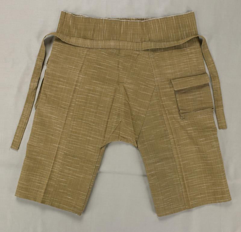 khaki-colored with white scattered lines; two pockets with top flaps at sides; attached waist tie