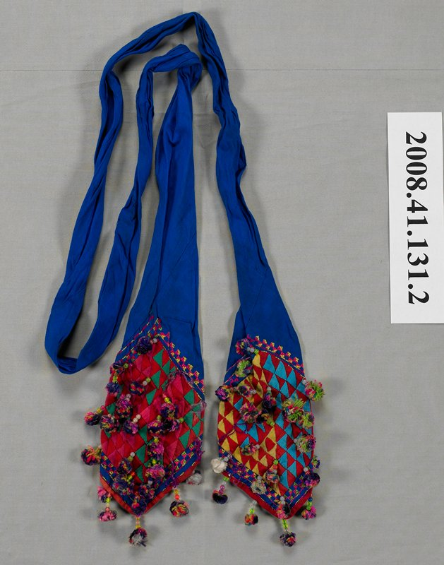 long blue sash with ends folded to form a point; multicolored appliqué, embroidery and small tassels on pointed ends; similar construction to a Western man's tie