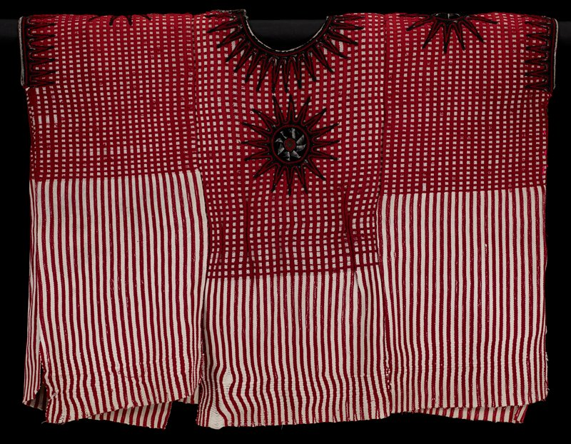 three panels sewn together; sides stitched under arm openings; vertical red and white striped fabric with checks formed from vertical and horizontal red stripes at top, front and back; four star-shaped medallions--one on each shoulder and chest and back--with black velvet centers and black and red stitching; black and red stitching around neck and arm openings; snap at PL neck