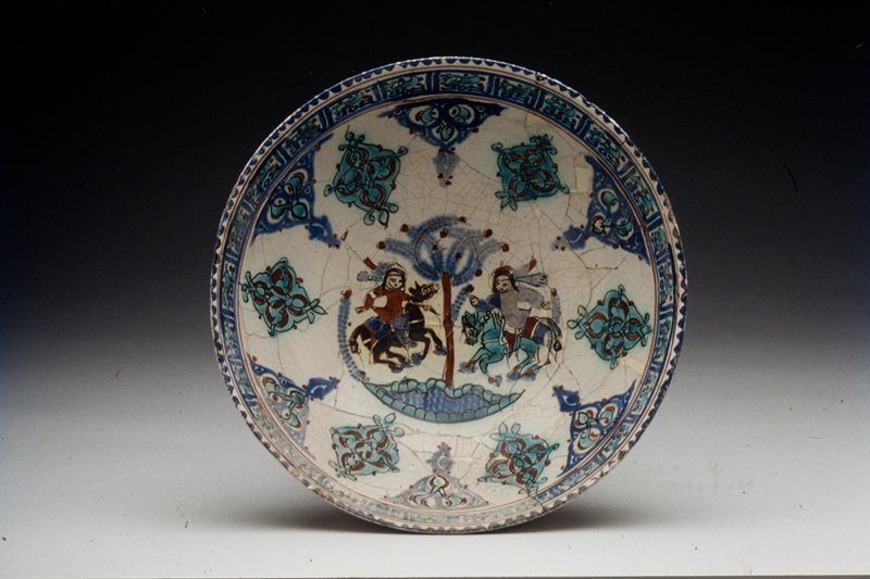 Bowl, overglaze painted ware; mounted ladies beside pool; polychrome overglaze.