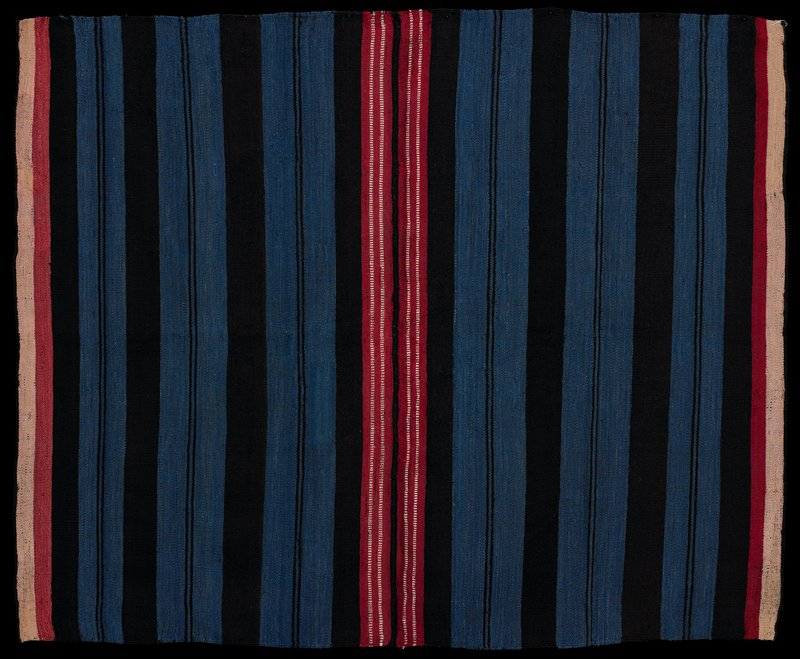 two pieces sewn together; brown and blue stripes on body; pink and tan at sides of each panel; warp faced plain weave