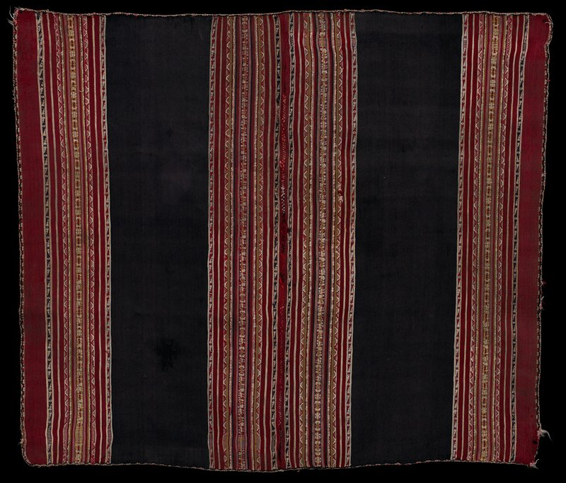 two pieces sewn together; predominantly brown and red with stripes in red, pink, yellow, white, blue and purple with white patterning on some stripes; trimmed with diamond patterned edging; warp faced plain weave with complimentary warp woven pattern bands and tubular woven edge finish