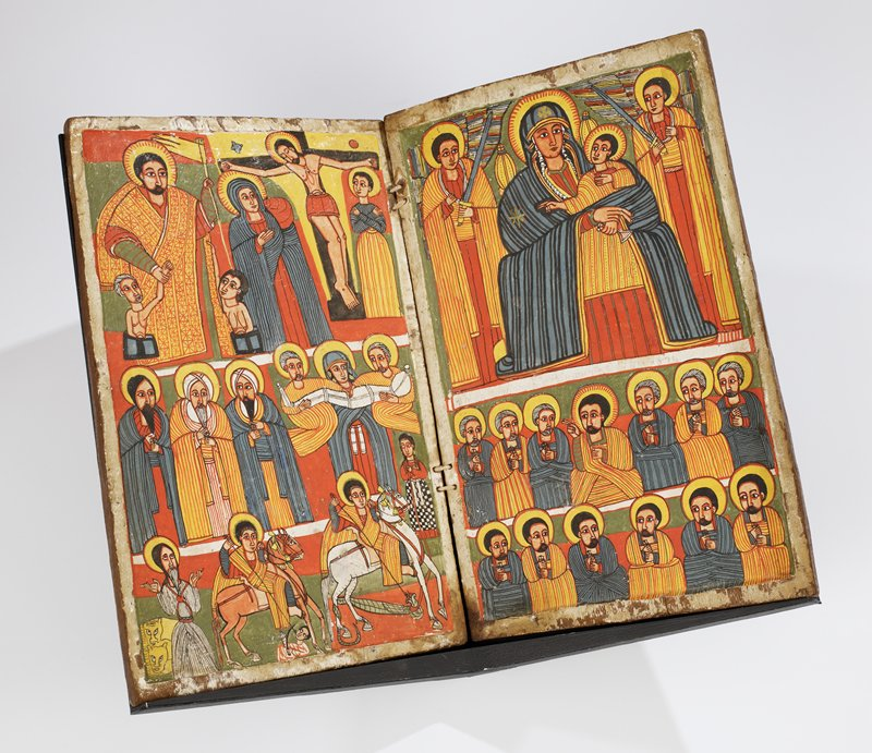 two wood panels attached in book form with string; traces of gesso and fragments of running border designs in black on outer front cover; each inner panel split into three horizontal frames showing various scenes including Jesus with the 12 apostles, Mary and infant Jesus with a pair of angels with swords, the crucifixion, Daniel with two lions and St. George slaying a serpent-like dragon; orange, yellow, grey-blue, black and white