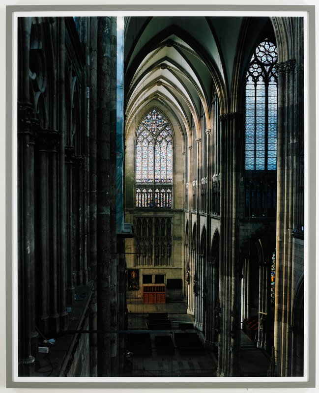 No. 12282; view down one arm of cathedral with abstract, multi-colored stained glass window at end; grey frame with Plexiglas