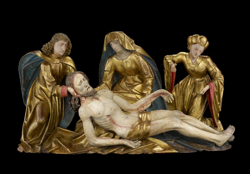 three standing figures with Jesus' reclining body; Jesus wears gold loincloth and has curly hair and curling pointed beard; Mary at center wearing gold garment and head cloth, lined in blue; Mary Magdalene wearing gold cap and garment with red sleeve lining and holding a gold cylindrical container; man (Joseph?) with long curly hair at left wearing gold garment and cape with blue lining