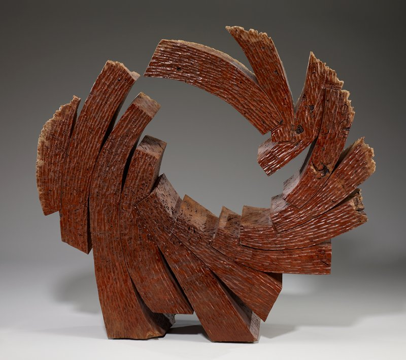 05-13; abstracted circular outline made by attaching together several pieces of curving pieces of wood