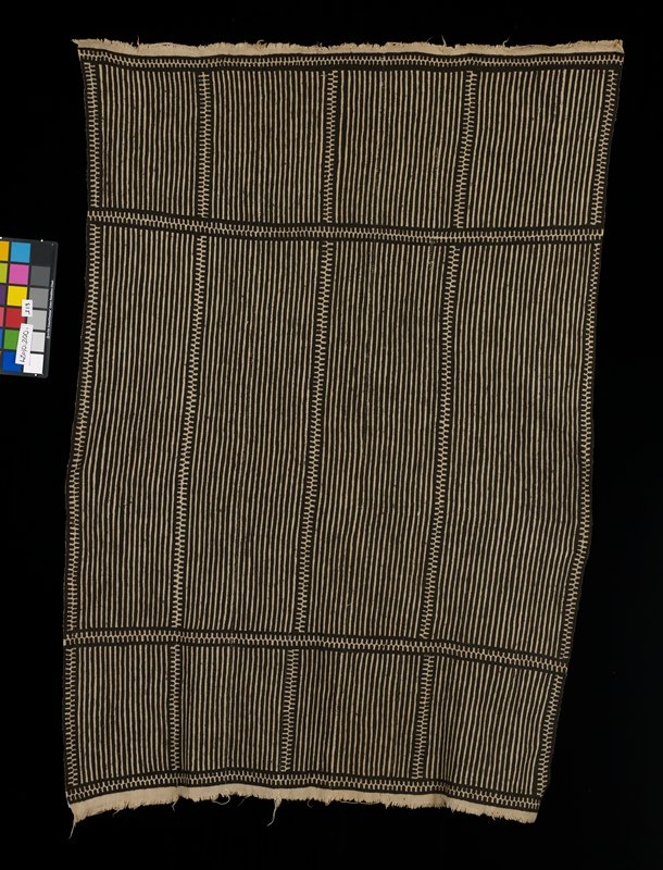 light brown, nine paneled mud cloth skirt with dark brown striped design and abstract borders; short light brown fringe