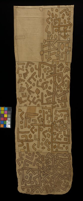 long tan textile with appliquéd tan and brown geometric shapes; the geometric shapes include circles, squares, and lines bent at a 90 degree angle; edges are hemmed