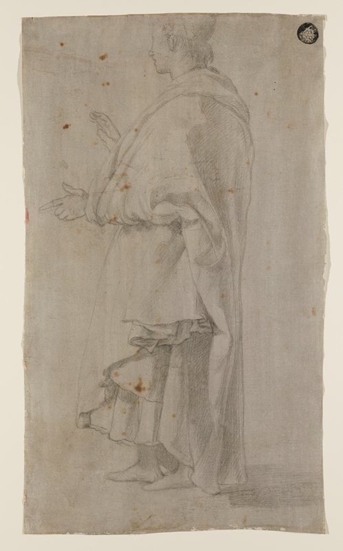 standing youth wearing heavy draperies--cloak over long skirt; figure seen from PL, gesturing