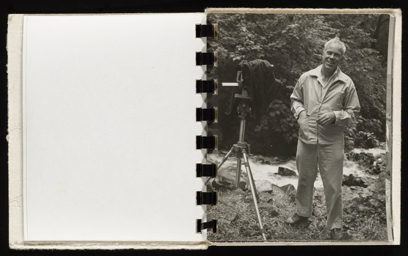 small booklet with grey paper covers bound with black plastic spiral; 15 portraits of Minor White speaking and photographing outdoors