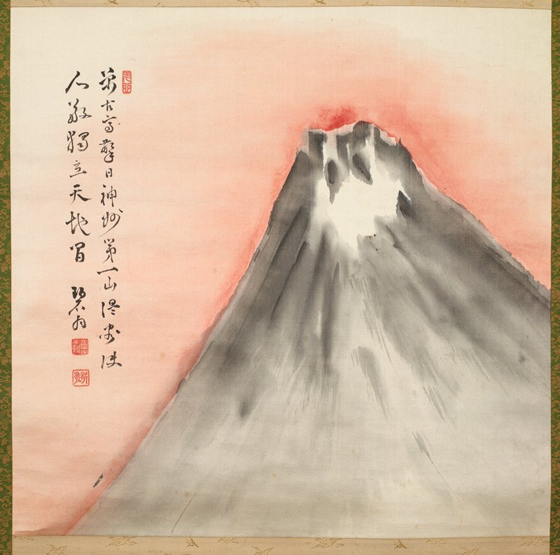 cream paper carton with tan stripes, wooden box with inscriptions; wrapped in tissue; tan and green/gold fabric; image of a mountain with red around it; two line inscription along L edge