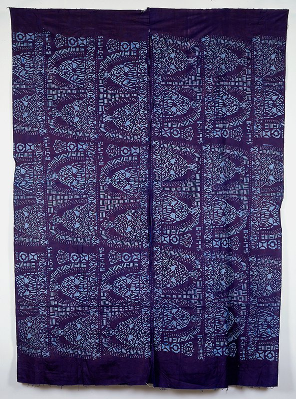 cotton plain weave; tie dyed to result in a pattern of light blue; two panels sewn together; adire cloth