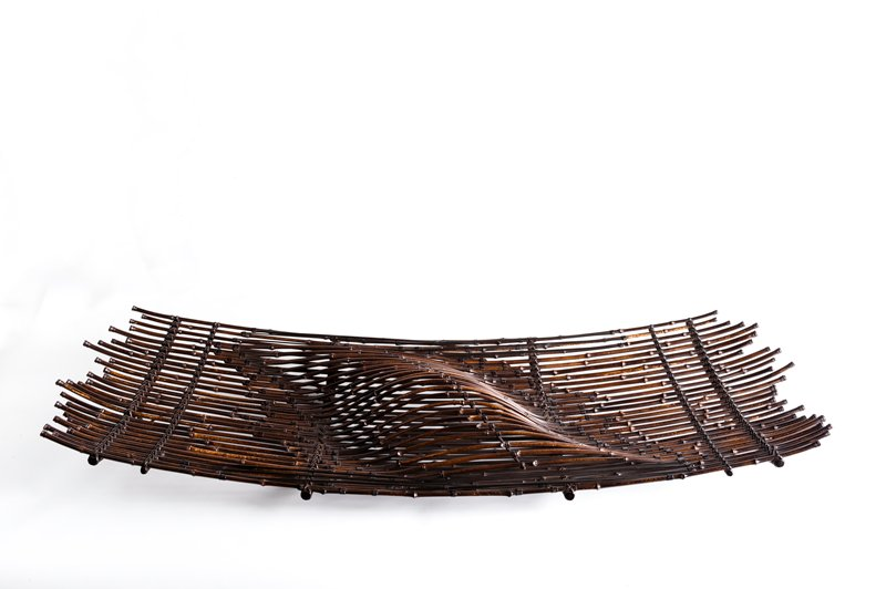 rectangular form with uneven ends; made of thin bamboo sticks; organic, oval form rising at C