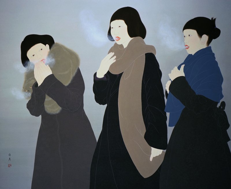 three young women in dark winter coats, bundled under big puffy scarves; woman at L wears an animal fur with face around her neck, and is warming her fingers in front of her mouth; the other wo women are watching the vapors from their breath; light gray background
