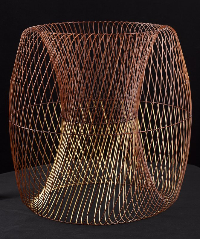 delicate drum-shaped form with hollow cylindrical center; thin bamboo strips woven at diagonal create spiral pattern; interior of bamboo pieces painted gold on one half