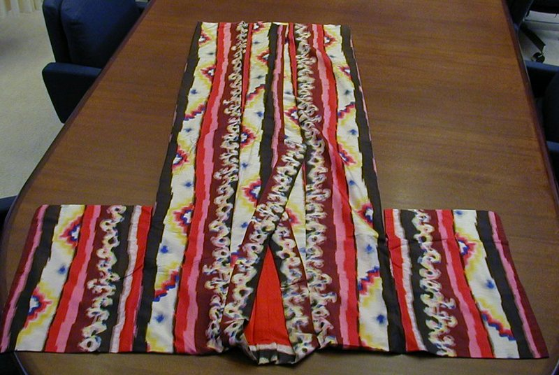 burgundy, red, pink, black, and white vertical motif with some vertical floral designs in white, blue, pink, and yellow
