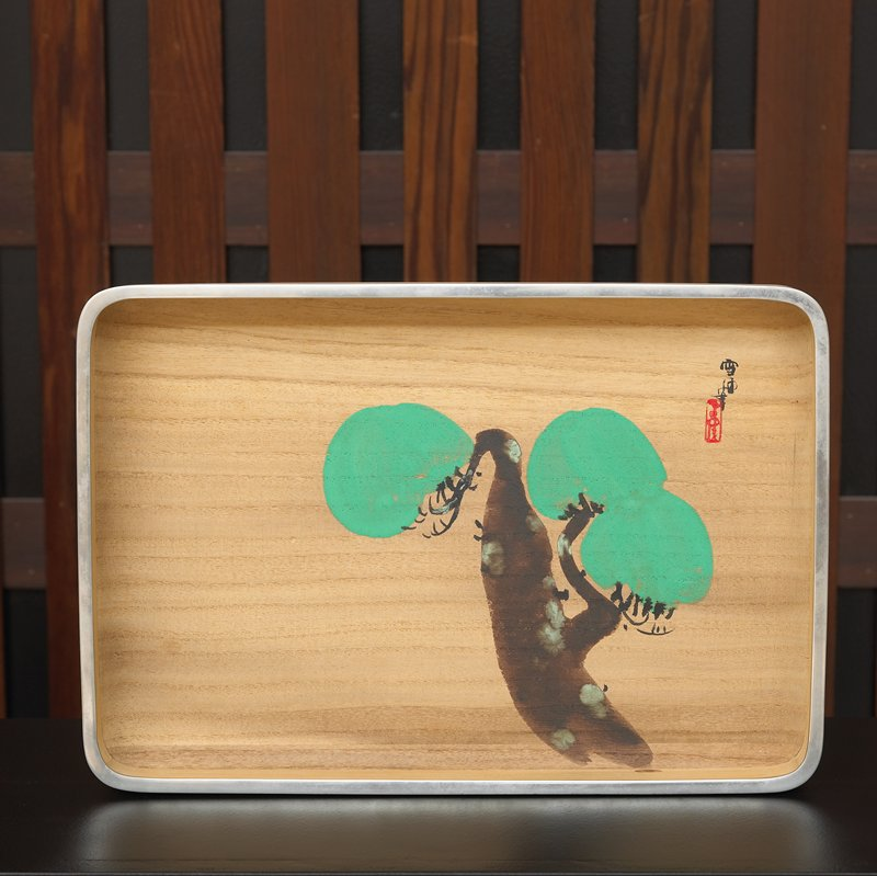 wooden tray with tree: wide brown trunk with moss; three puffs of green foliage; silver rim; rounded edges